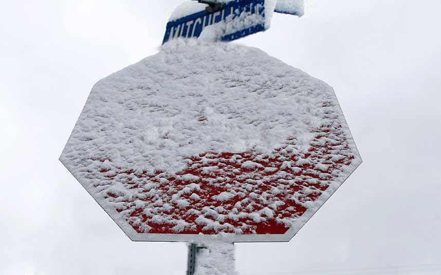 Stop sign covered in snow